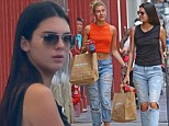 Kendall Jenner is edgy in ripped jeans and combat boots as she enjoys a shopping spree with gal pal Hailey Baldwin in New York