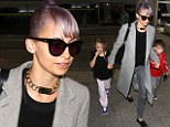 Nicole Richie keeps a grip on her kids at LAX after getting in some husband and wife time with Joel Madden in Australia