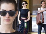 A modern man indeed! Anne Hathaway's husband carries her monogrammed tote bag during New York stroll