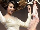 Hair-raising! Vampire Diaries star Nina Dobrev hams it up to promote shampoo line in China