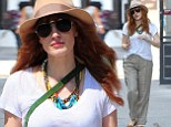 Keeping it casual! Jessica Chastain hides her A-list frame under a pair of baggy but chic khakis