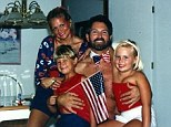 Strange: The father of this family appears to be wearing only a patriotic bow-tie in this photo with his wife, son and daughter