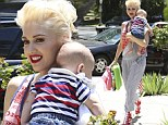 Her little patriot! Gwen Stefani dons striped dungarees as she carries four-month-old son Apollo draped in red, white and blue