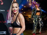 R.I.P. fashion! Rita Ora turns heads in bizarre ruffled jeans and black crop top as she flicks colourful extensions around during upbeat set in Madrid