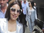 Lady Gaga trades big curly wig for long straight locks as she suits up in metallic blue suit in Montreal