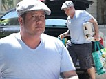 He's keeping the weight off! Chaz Bono displays his slimline physique in fitted T-shirt on grocery run