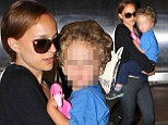 Natalie Portman is a cool traveller as she dons sunglasses while carrying her son Aleph through terminal at LAX