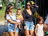Double denim: Kim joined her sister and her niece and nephew for the farm trip
