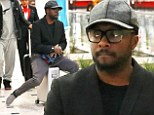 The Rolling Pea! Will.i.am scoots along on top of his briefcase as he touches down in Sydney for live Voice Australia shows