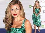 The envy of the room! Katherine Jenkins looks stunning in floral 1950s-style green dress and nude stilettos at Silver Clef Awards