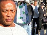 Doggy bag: Dr Dre carried a bag of leftovers after eating with his wife on Thursday at a restaurant in Santa Monica, California
