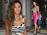 Wild thing! Nicole Scherzinger shows off her shapely body in a hot pink animal-print dress for London radio appearance