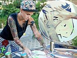 Model, DJ...vinyl artist? Ruby Rose gets creative as she spruces up her ride with spray paint designs