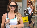 Whatever the weather: Sam Faiers braves the Manchester rain in casual workout gear as she tops up her wardrobe at Selfridges