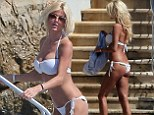 Cooling off: Victoria Silvstedt showed off her figure in a tiny white bikini as she took a dip at the Hotel Du Cap-Eden-Roc in the South Of France