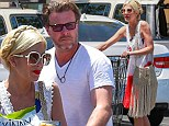No festive feelings here: Tori Spelling and Dean McDermott make a glum couple on July 4 family shopping trip