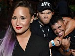 Glam: Demi Lovato donned a clinging black mini-dress teamed with a black blazer as she sat in the audience watching the mixed martial arts competition, which was also attended by Kellan Lutz