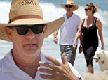 Turner and pooch! Tom Hanks and wife Rita Wilson take their adorable dog for a walk on the beach in Malibu
