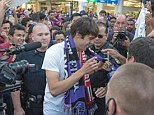Hero's welcome: Kaka is mobbed by Orlando City fans after arriving at the international airport