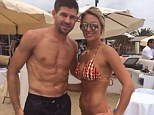 Pose: Steven Gerrard and his wife Alex pose for a photo in Nassau Beach in Ibiza