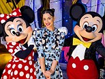 Happiest place on Earth! Katy Perry struck playful poses with Minnie and Mickey Mouse at Disney World on Friday