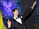 Serving up a treat: Novak Djokovic was all smiles as he celebrated winning his second Wimbledon title
