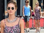 Doggy double date! Candice Swanepoel shows off toned pins as she walks dogs with boyfriend Hermann Nicoli