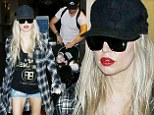 Fergie shows off her lean legs in short shorts at the Los Angeles airport with Josh Duhamel and baby Axl