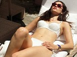 Any excuse! Emmy Rossum drags out 4th of July celebrations... as she marks day the bikini was invented by posing in a two-piece