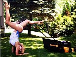 'First time mowing!' Hilaria Baldwin performs a forearm stand in heels and straw hat while doing some yard work