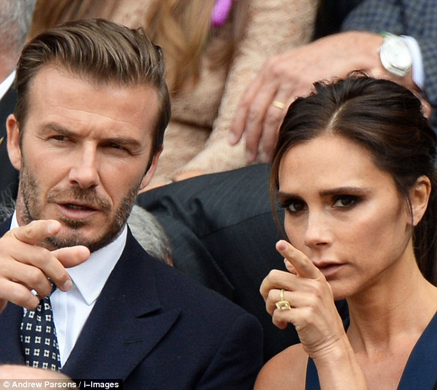 His and hers: Both David and Victoria chose navy for the sporting occasion