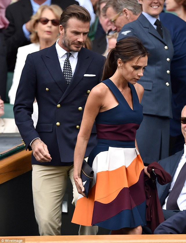 Stepping out in style: David and Victoria coordinated their navy outfits perfectly