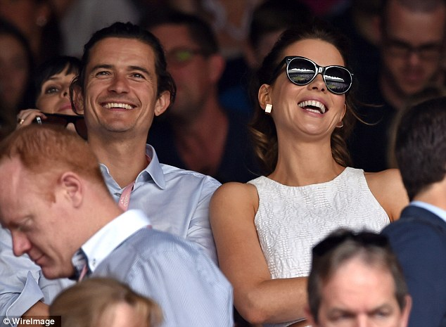 Lot of laughs: Orlando Bloom and Kate Beckinsale sit in the stands for the final day of Wimbledon
