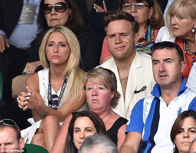 Confused? Olly Murs looked puzzled as he watched Federer and Djokovic battle it out