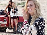 Fair-weather friends! Poppy Delevingne flashes pins in burgundy shorts as she cosies up to pal Alexa Chung next to red convertible during shoot in Ibiza