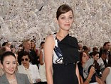 Lady Dior: Marion took front row at the Haute Couture Dior show dressed in an origami neck black dress