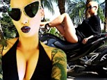 'MILF': Amber Rose reclined atop a motorcycle, wearing only a black bikini with a sheer wrap in an Instagram snap posted on Sunday