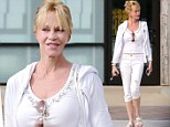 Melanie Griffith cuts a fashionable figure in all-white ensemble in the midst of divorce from Antonio Banderas