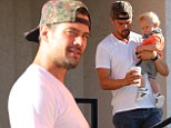 Hunky father: Josh Duhamel showed off his rugged good looks as he took his son Axl out for coffee at Early World Restaurant in Brentwood, California on Sunday