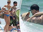Turning up the heat! Cameron Diaz and beau Benji Madden frolic in the Florida surf as actress shows off her impressive bikini body