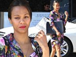 Trying to hide something are we? 'Pregnant' Zoe Saldana holds strategically placed shopping bag over her belly in Los Angeles