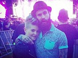 Cosying up: Ricki posted a snapshot featuring himself and Kelly at the Hyde Park Black Sabbath gig