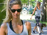 Gisele Bundchen turns the footpath into her own private runway as she displays her lithe figure in flattering workout gear during stroll with pit bull Lua in Boston
