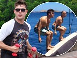 Work hard, play hard! Zac Efron embarks on fitness session with businessman pal Gianluca Vacchion before performing impressive ocean backflip