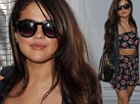 Eat your heart out, Justin! Selena Gomez shows off her toned torso in floral short cropped top and shorts at 4th of July party