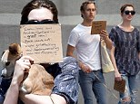 Back for seconds! Anne Hathaway and husband Adam Shulman promote charities on cardboard signs AGAIN