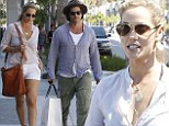 He's handy! Elizabeth Berkley's husband Greg Lauren takes care of her bags on serious Beverly Hills shopping spree
