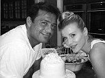 Wedding cake: Romain Zago shared an Instagram snap of himself with wife Joanna Krupa on Sunday celebrating their one-year anniversary with the top tier of their wedding cake