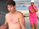 Ditching the Wimbledon whites! Rafael Nadal flashes toned torso in fuchsia shorts on board luxury yacht in Ibiza as he cheers himself up after shock defeat