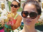 Blooming lovely! Barefaced Brooke Burke-Charvet stops to smell the flowers as she does some shopping at the Farmer's Market in Malibu